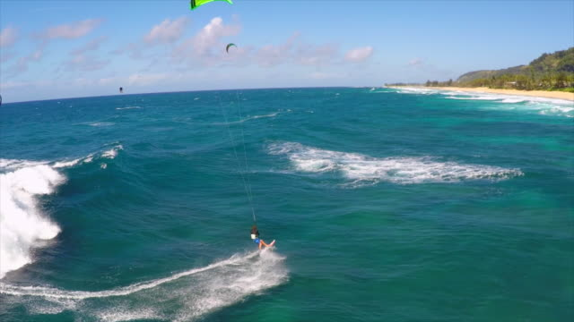 Aerial view of a man kitesurfing in Hawaii. - Slow Motion