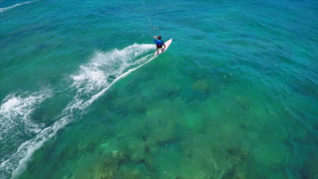 aerial view of a man kitesurfing in hawaii. - slow motion - surf video stock e b–roll