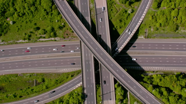 aerial view of a motorway junction m25 m40, uk. 4k - segnaletica stradale video stock e b–roll