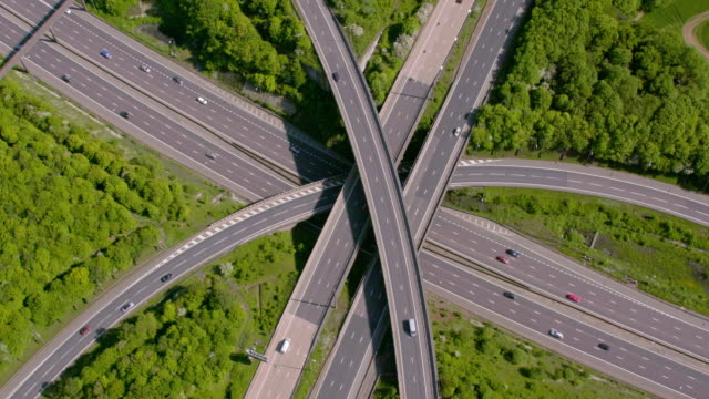 aerial view of a motorway junction m25 m40, uk. 4k - road sign stock videos & royalty-free footage