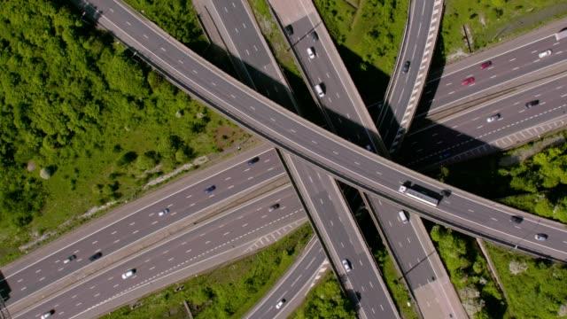 aerial view of a motorway junction m25 m40, uk. 4k - traffic stock videos & royalty-free footage