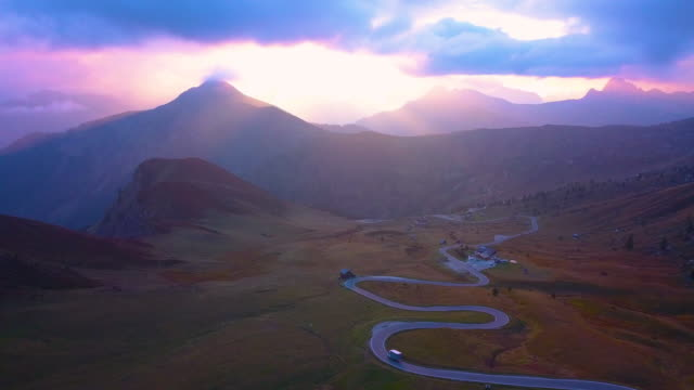 Aerial view of a mountain road in Dolomites Alps at sunset