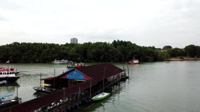 aerial view of a moving boat near docks in gelang patah johor malaysia - johor stock videos & royalty-free footage