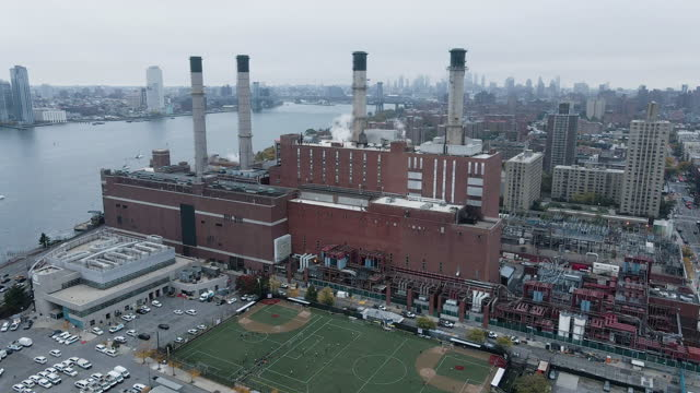 aerial view of a new york city factory on a cloud day - east river new york city stock videos & royalty-free footage