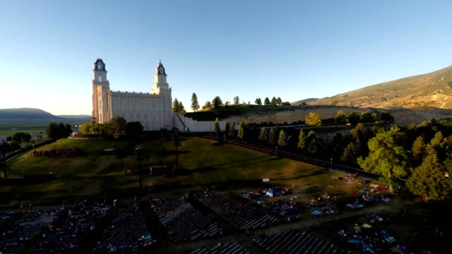 aerial view of a pageant occuring at the mormon temple in manti  utah - mormon temple stock videos and b-roll footage