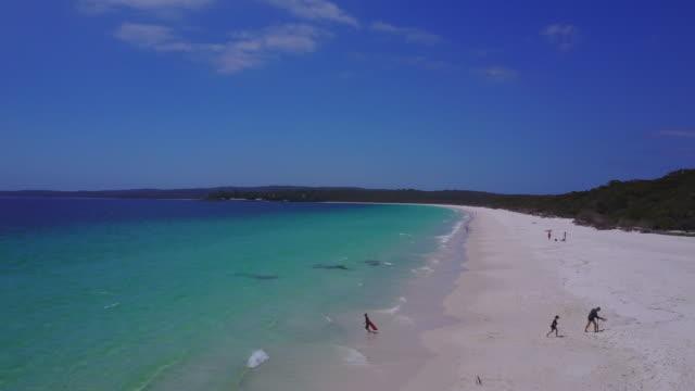 4k aerial view of a paradisiac beach, hyams beach, jervis bay, australia - noelia ramon stock videos & royalty-free footage