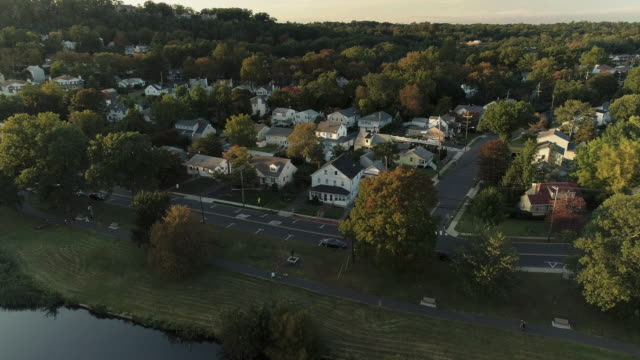 aerial view of a park and residential area in springfield, new jersey, usa, at sunset. drone video with the ascending and tilting-down camera motion. - new jersey stock videos & royalty-free footage