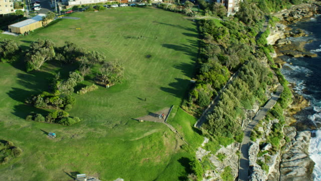 aerial view of a park overlooking bondi bay - natural parkland stock videos & royalty-free footage