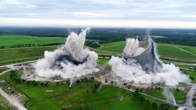 aerial view of a power plant demolition in jacksonville florida - power station stock videos and b-roll footage