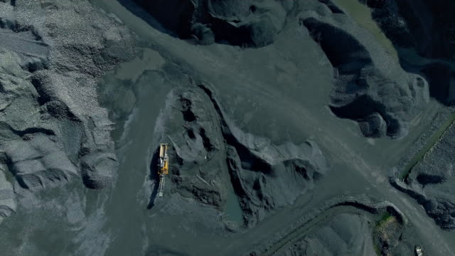 aerial view of a quarry camera moving up - coal mine stock videos & royalty-free footage