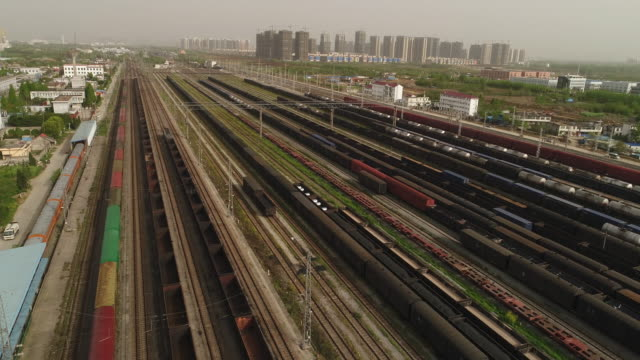 aerial view of a railway shunting yard - shunting yard stock videos and b-roll footage