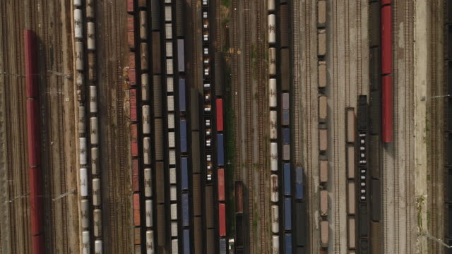 aerial view of a railway shunting yard - flugzeugperspektive stock-videos und b-roll-filmmaterial