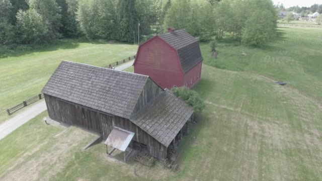 aerial view of a red barn in langley, british columbia - barn stock videos & royalty-free footage