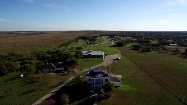 Aerial view of a Red Barn on a Ranch in Salado Texas