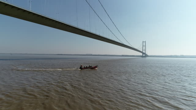 aerial view of a rescue boat patrolling the humber - hull stock videos & royalty-free footage