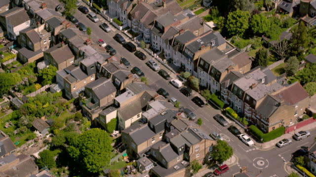 aerial view of a residential street in outer london, uk. 4k - real estate stock videos & royalty-free footage