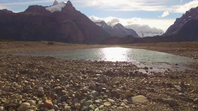 stockvideo's en b-roll-footage met aerial view of a river and mountains at patagonia, argentina - grind