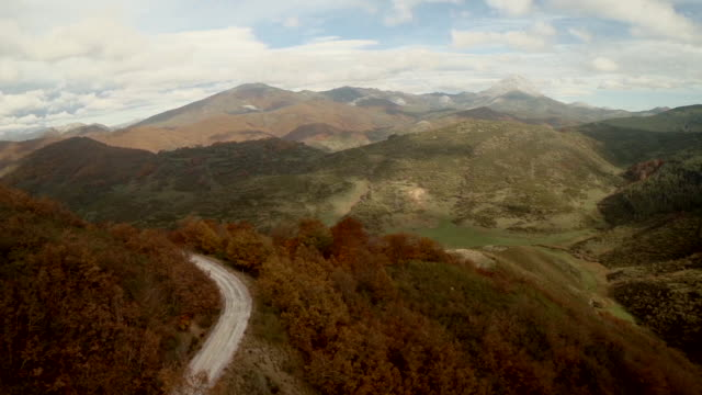 Aerial view of a road and mountains in Autumn
