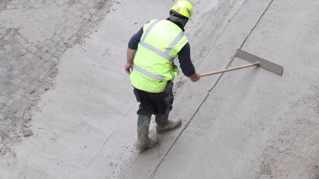 aerial view of a road construction site - cement stock videos & royalty-free footage