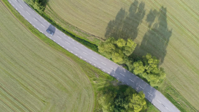 aerial view of a road - country road stock videos & royalty-free footage