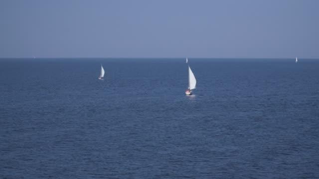 stockvideo's en b-roll-footage met luchtfoto van een zeilboot in duitsland - rondrijden