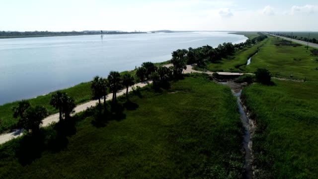 Aerial view of a Sand trail next to water in Tybee Island Georgia