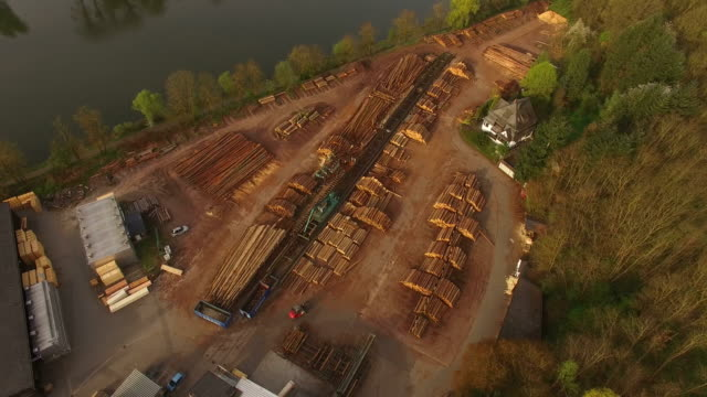 aerial view of a sawmill - lumberyard stock videos and b-roll footage