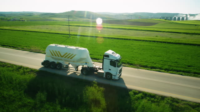 aerial view of a semi-trailer on the road in beautiful countryside - tank stock videos & royalty-free footage