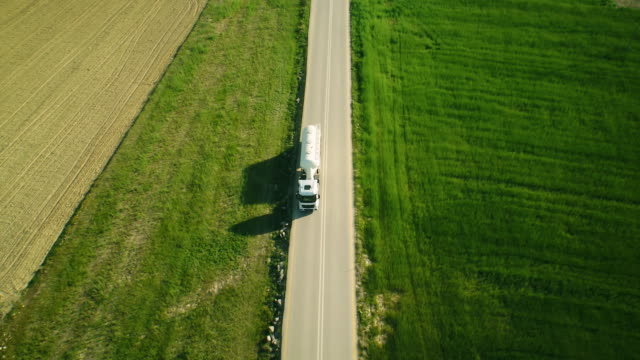 aerial view of a semi-trailer on the road in beautiful countryside - trucking stock videos & royalty-free footage
