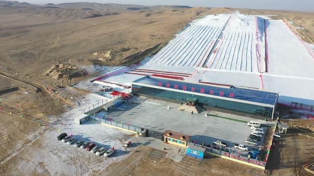 aerial view of a ski resort in the desert at lop county on december 26, 2020 in hotan prefecture, xinjiang uygur autonomous region of china. - 新疆ウイグル自治区点の映像素材/bロール