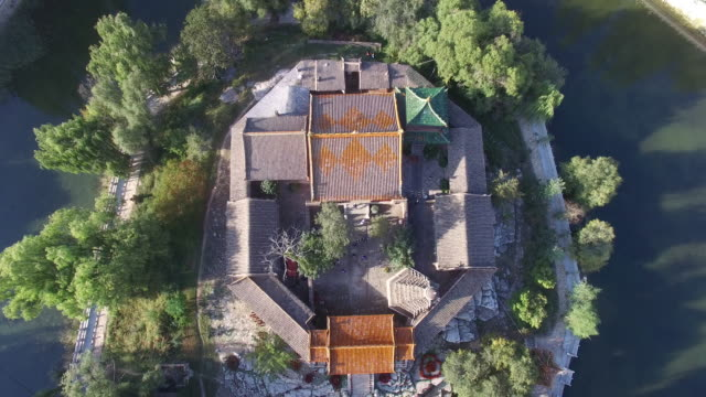 aerial view of a small temple surround with small lake - moat stock videos and b-roll footage