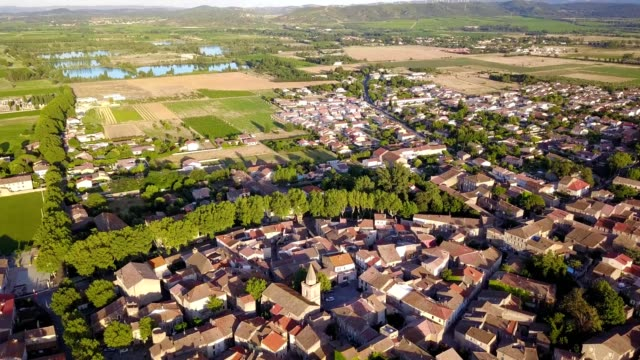 aerial view of a small village with a church in languedoc region of canet d'aude france - french culture stock videos & royalty-free footage