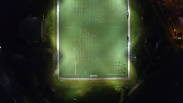 vídeos y material grabado en eventos de stock de aerial view of a soccer sports ground at night. - campo de fútbol