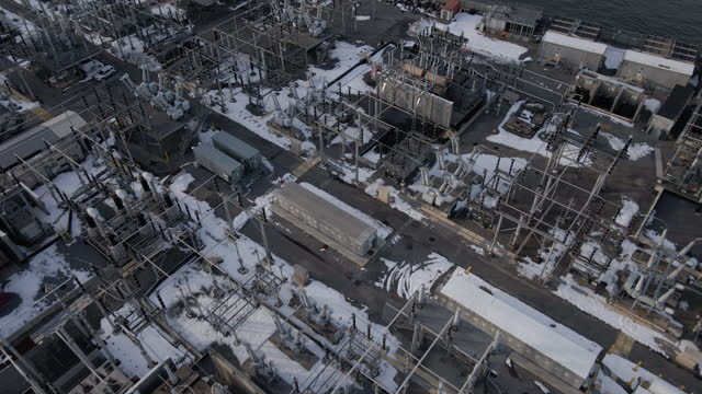 stockvideo's en b-roll-footage met aerial view of a substation during the winter - stroomtransformator