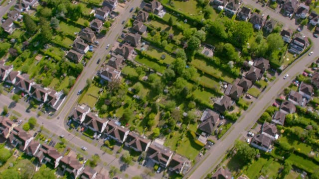 aerial view of a suburban housing estate in sunshine. 4k - lawn stock videos & royalty-free footage