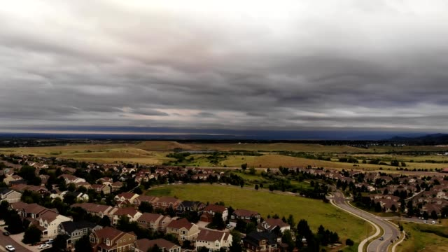 aerial view of a suburban neighborhood in lakewood colorado under storm clouds - colorado stock videos & royalty-free footage