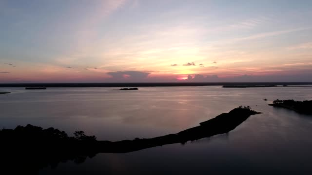 aerial view of a sunset on cape fear river in carolina beach north carolina - carolina beach stock videos and b-roll footage
