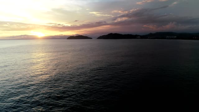 aerial view of a sunset on water in jaco, costa rica - costa rica stock videos & royalty-free footage