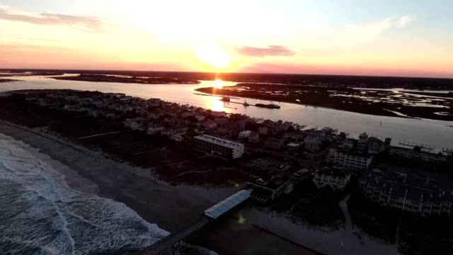 aerial view of a sunset over crystal pier in wrightsville beach north carolina - carolina beach stock videos & royalty-free footage