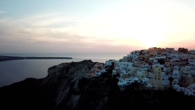 aerial view of a sunset over santorini thera greece - santorini stock videos and b-roll footage