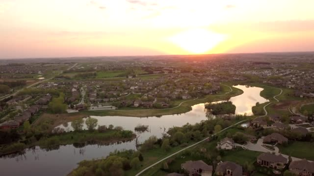 aerial view of a sunset over suburbs in omaha nebraska - nebraska stock-videos und b-roll-filmmaterial
