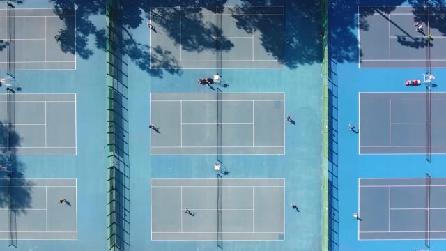 vídeos de stock e filmes b-roll de aerial view of a tennis courts in china - classificados
