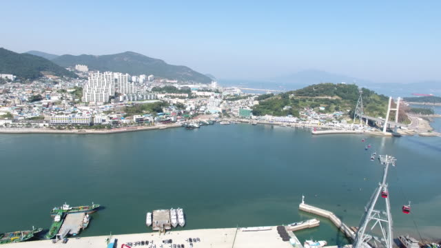 aerial view of a tourboat under the yeosu bridge - tourboat stock videos and b-roll footage