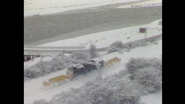 aerial view of a train as it ploughs through heavy snowfall in south-east england during arctic blizzards across the uk in january 1987. - snowing stock videos & royalty-free footage