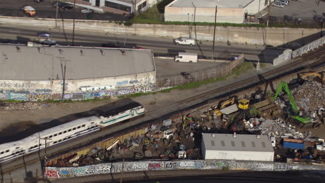 aerial view of a train passing an electronic waste recycling center in los angeles. - e waste stock videos & royalty-free footage