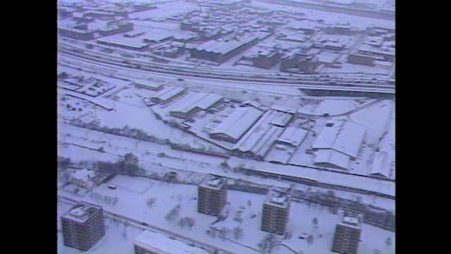 aerial view of a train stranded in snow in an unspecified part of scotland during arctic blizzards across the uk in january 1987. - telecommunications equipment stock videos & royalty-free footage