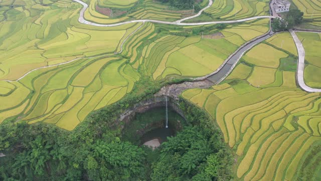 aerial view of a waterfall amongst terraced fields on september 13, 2021 in buyi and miao autonomous prefecture of qiannan, guizhou province of china. - winding road stock videos & royalty-free footage