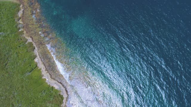 aerial view of a white sand cays and islands in the caribbean sea with turquoise waters - on top of stock videos & royalty-free footage