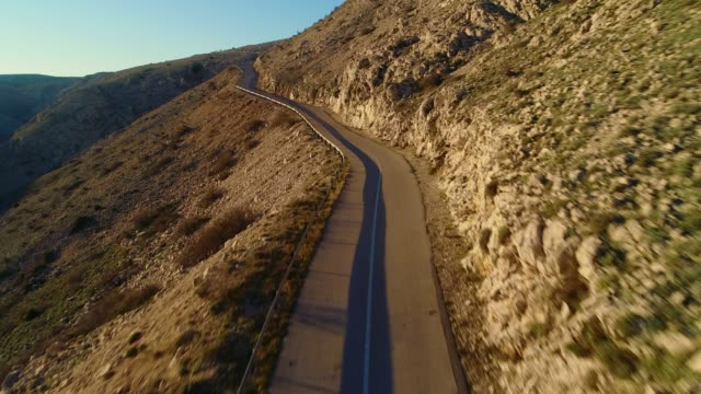 aerial view of a winding road at late afternoon - coastal road stock videos & royalty-free footage
