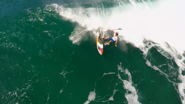aerial view of a wipeout sup stand-up paddleboard surfing in hawaii. - wipeout stock videos & royalty-free footage